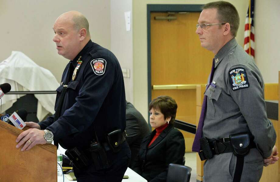 Police Chief Jonathan Teale, left, Supervisor Paula Mahan and NYSP Capt. Robert Patnaude, right, release details of the murder-suicide of officer Israel Roman and members of his family during a news conference Thursday Feb. 11, 2016 in Colonie, NY.   (John Carl D'Annibale / Times Union) Photo: John Carl D'Annibale / 10035392A