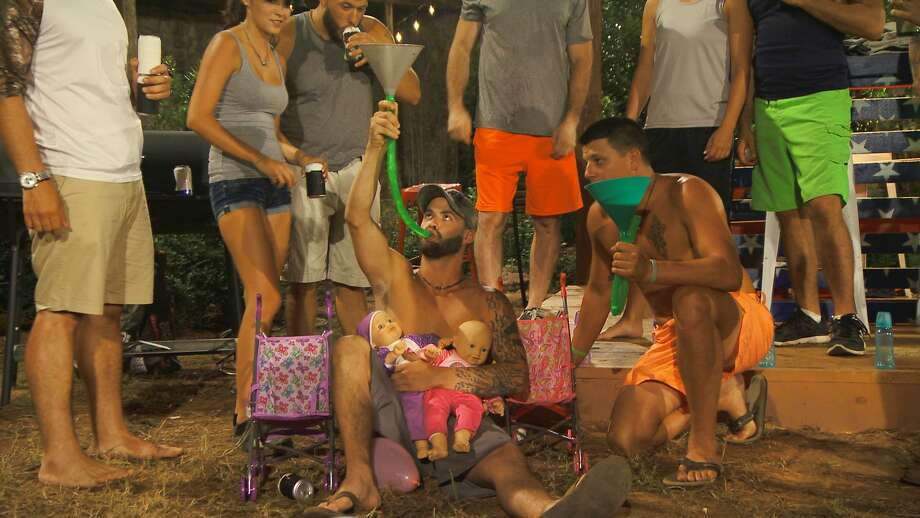 """Redneck baby showerTank hones his fatherly skills during a baby shower on Redneck Island. At the beginning of Thursday's episode, he learned his girlfriend was pregnant with a """"Baby Tank."""" Photo: CMT"""