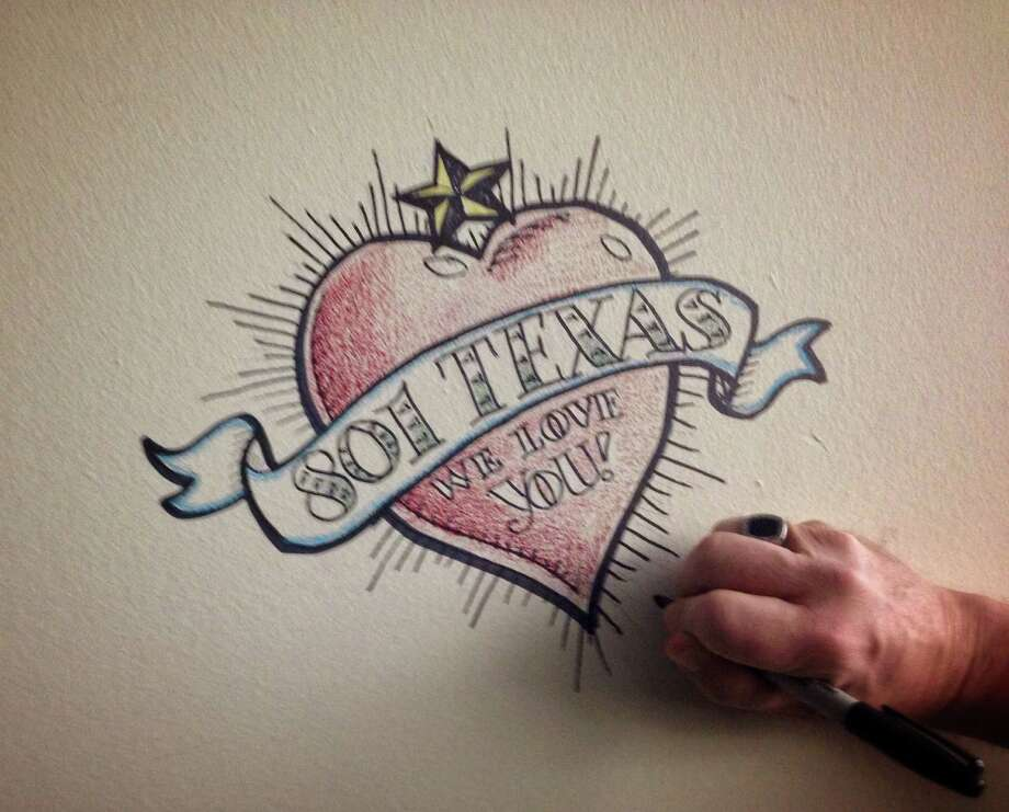 As the Chronicle prepares to leave 801 Texas, which will be demolished, graphic artist Ken Ellis has begun to draw on the building's walls. Photo: Lisa Gray