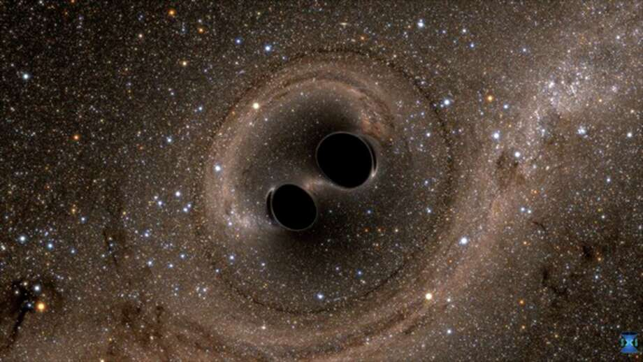 The collision of two black holes holes -- a tremendously powerful event detected for the first time ever by the Laser Interferometer Gravitational-Wave Observatory, or LIGO -- is seen in this still from a computer simulation created by the multi-university SXS (Simulating eXtreme Spacetimes) project. Photo: SXS, McClatchy-Tribune News Service / LIGO