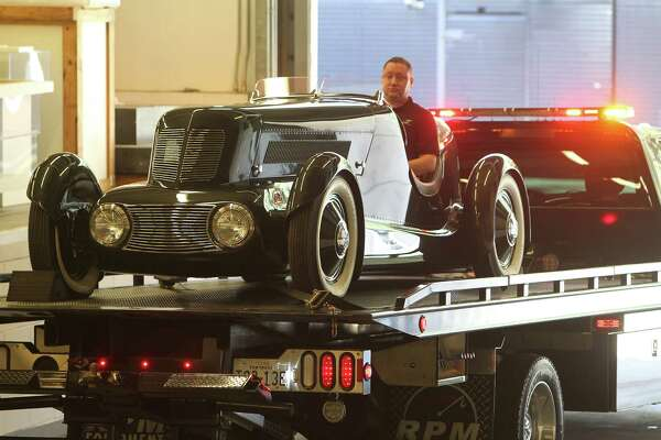 "Ford Motor Company Greg Stoner (behind wheel) in the Edsel Ford's personal Model 40 Special Speedster in to a dock at the Museum of Fine Arts, Houston Thursday, Feb. 11, 2016, in Houston. The MFAH is getting 17 Art Deco cars and motorcycles into the museum for its ""Sculpted in Steel"" exhibition."