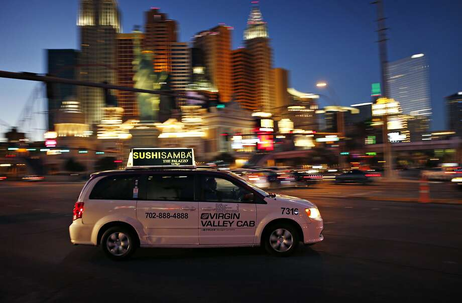 A taxi cruises down Las Vegas Boulevard. The advent of Uber and Lyft in Nevada last fall has thrown the powerful taxi industry into upheaval. Photo: John Locher, Associated Press