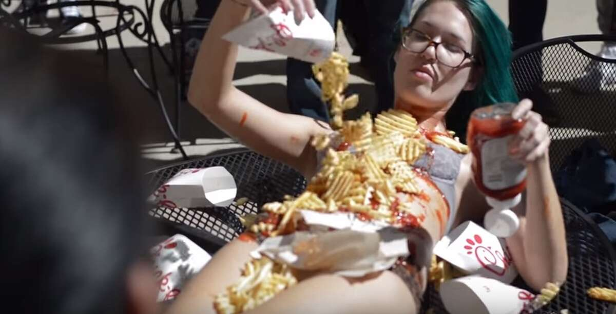 College student covered in Chick-fil-a lies nearly-naked on table This live-art performance by fine arts student, Monika Rostvoldcaused a serious stir at Texas State University. This was her second controversial display on the campus.