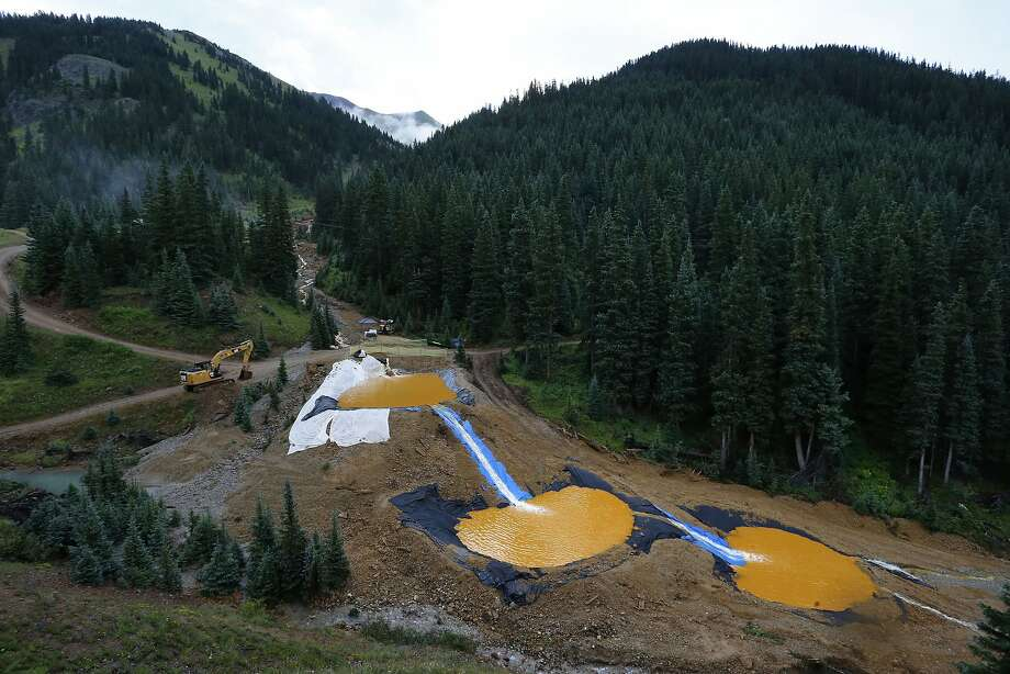 Water flows through a series of retention ponds built to filter out heavy metals and chemicals from the Gold King mine outside Silverton, Colo. Photo: Brennan Linsley, Associated Press