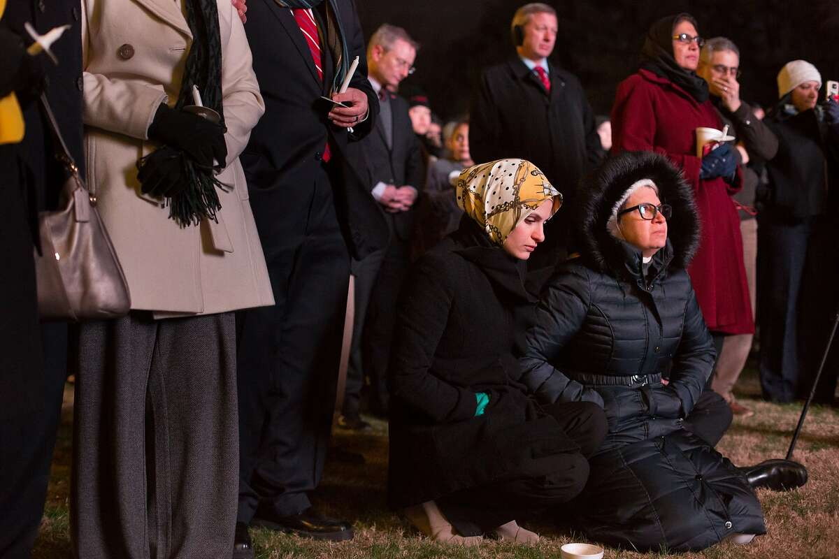 Suzanne Barakat (center) and her mother Layla Barakat (right) on the one-year anniversary of the murder of her brother Deah Barakat, his wife Yusor Mohammad Abu-Salha and her sister Razan Mohammad Abu-Salha (ALL NAMES CQ). A vigil was held in their honor at North Carolina State University in Raleigh, NC on Wednesday, February 10, 2016.