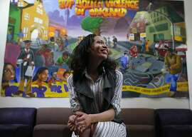 Former Oakland police officer Holly Joshi is seen in front of a mural at Youth Uprising in Oakland, Calif. on Thursday, Feb. 11, 2016, where she is the deputy director.
