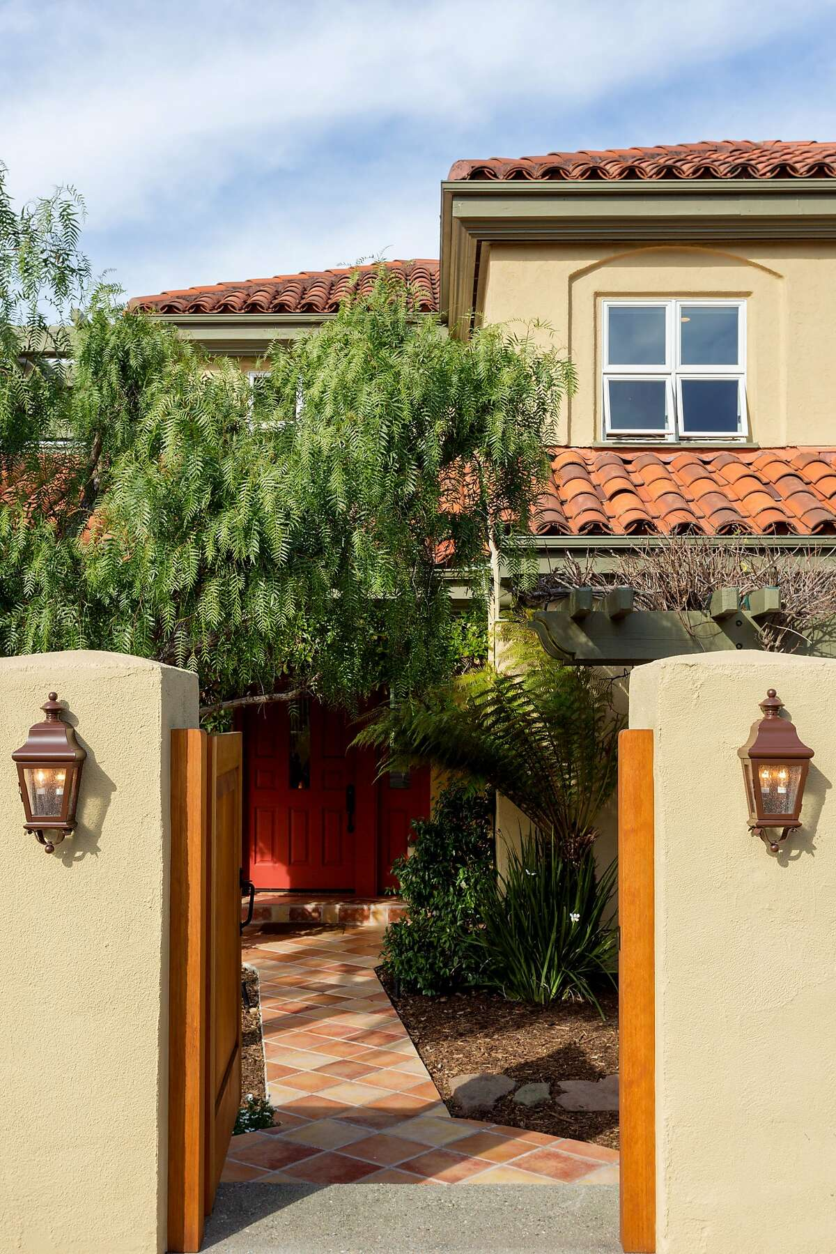 A handmade entry gate introduces the Upper Rockridge property.