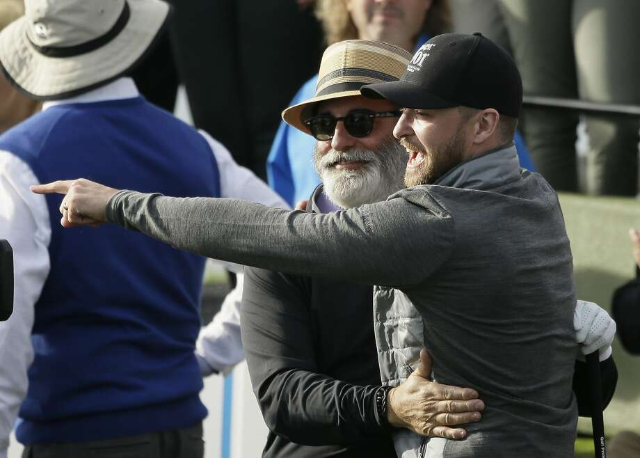Andy Garcia, left, is greeted by Justin Timberlake, right, after hitting from the seventh tee of the Pebble Beach Golf Links during the inaugural $1 million celebrity hole-in-one event of the AT&T Pebble Beach National Pro-Am golf tournament Wednesday, Feb. 10, 2016, in Pebble Beach, Calif. (AP Photo/Eric Risberg) Photo: Eric Risberg, Associated Press