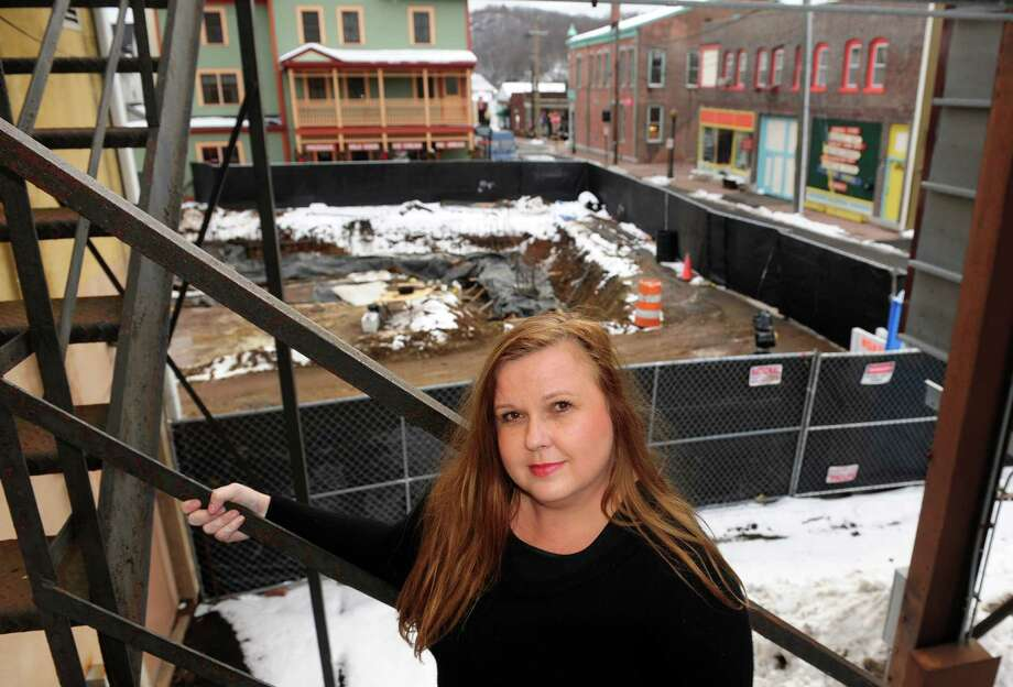 Kim Dulka stands in front of a large construction site next to her business: The All-American Valley General Store, seen in the background, on Bank and Columbus Streets in Seymour, Conn., on Wednesday Feb. 10, 2016. The new senior housing complex being built is making a bad situation worse with regards to parking in downtown. Photo: Christian Abraham / Hearst Connecticut Media / Connecticut Post