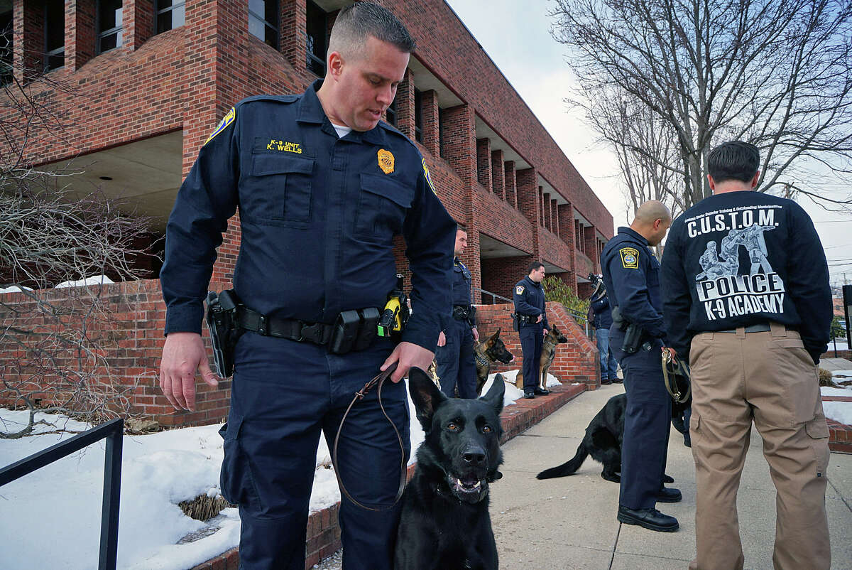 Officer Kevin Wells and his new canine partner, Jagger, following a graduation ceremony Thursday.