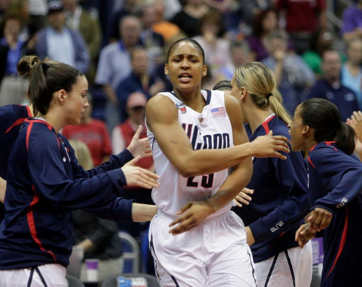 Connecticut's Maya Moore is introduced at the start of the women's NCAA Final Four college basketball championship game against Stanford Tuesday, April 6, 2010, in San Antonio. (AP Photo/Sue Ogrocki)
