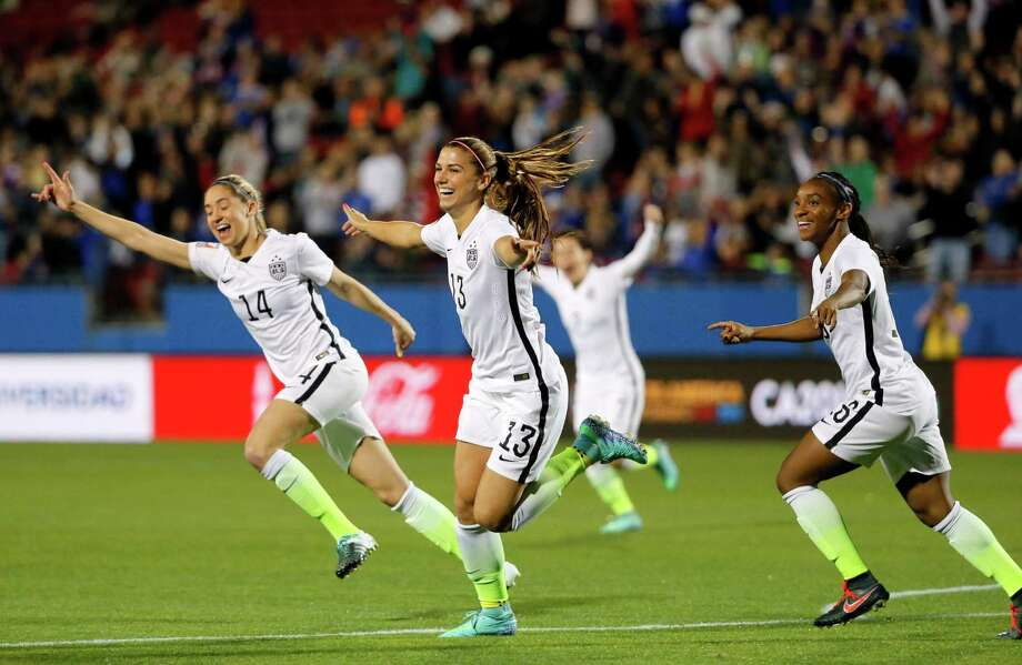 Unites States' Alex Morgan (13), Morgan Brian (14) and Crystal Dunn, right, celebrate a goal by Morgan against Costa Rica during the first half of a CONCACAF Olympic qualifying tournament soccer match Wednesday, Feb. 10, 2016, in Frisco, Texas. Photo: Tony Gutierrez, AP / AP