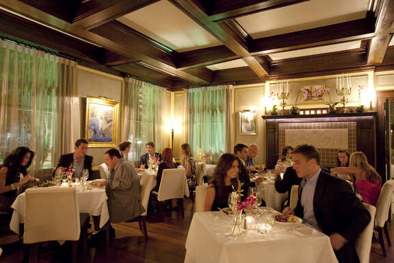 The main dining room at Restaurant Cinq. The fine dining restaurant is in La Colombe d'Or Hotel, 3410 Montrose, Houston.