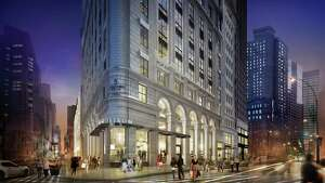 This rendering of the Nordstrom's planned New York flagship store shows the store at the corner of West 58th Street and Broadway at night.