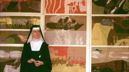 Corita Kent at a 1964 exhibit of her work