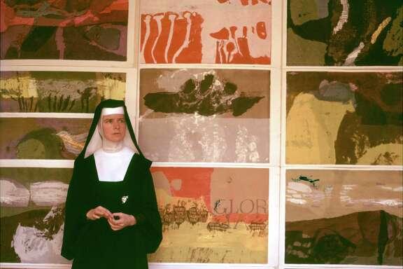 Corita Kent at a 1964 exhibit of her work