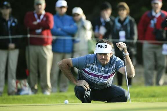 Bubba Watson looks over his putt on the second hole on the Spyglass Hill Golf Course during the first round of play, on Thurs. February 11, 2016, at the AT&T Pebble Beach Pro-Am, in Pebble Beach, California.