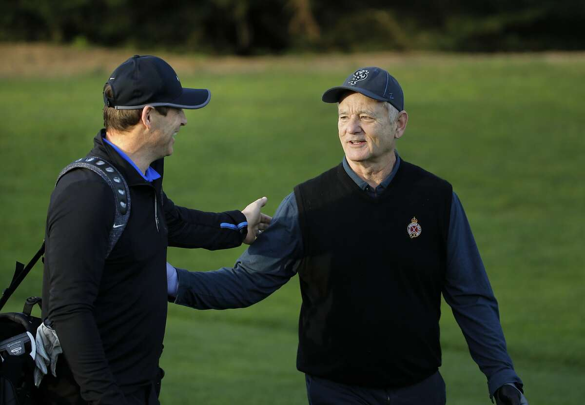 Former 49er quarterback Steve Young (left) makes a point to greet Bill Murray on the first hole as he plays the Spyglass Hill Golf Course during the first round of play, on Thurs. February 11, 2016, at the AT&T Pebble Beach Pro-Am, in Pebble Beach, California.