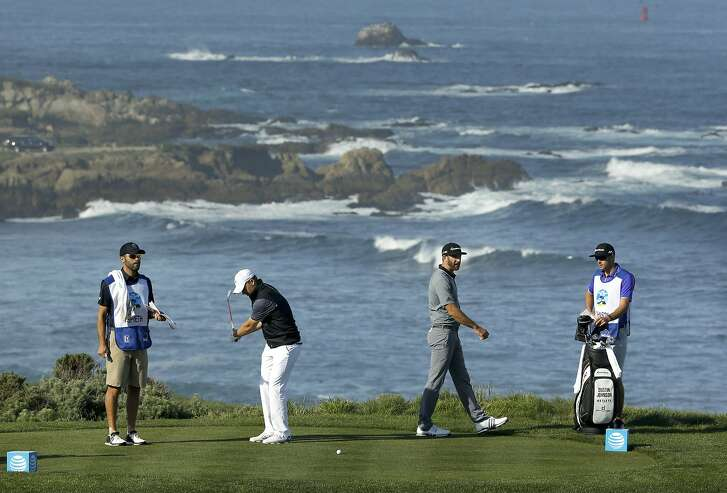 Jordan Spieth, (left center) and Dustin Johnson, (right center) get set to play the fourth hole at Spyglass Hill Golf Course during the first round of play, on Thurs. February 11, 2016, at the AT&T Pebble Beach Pro-Am, in Pebble Beach, California.
