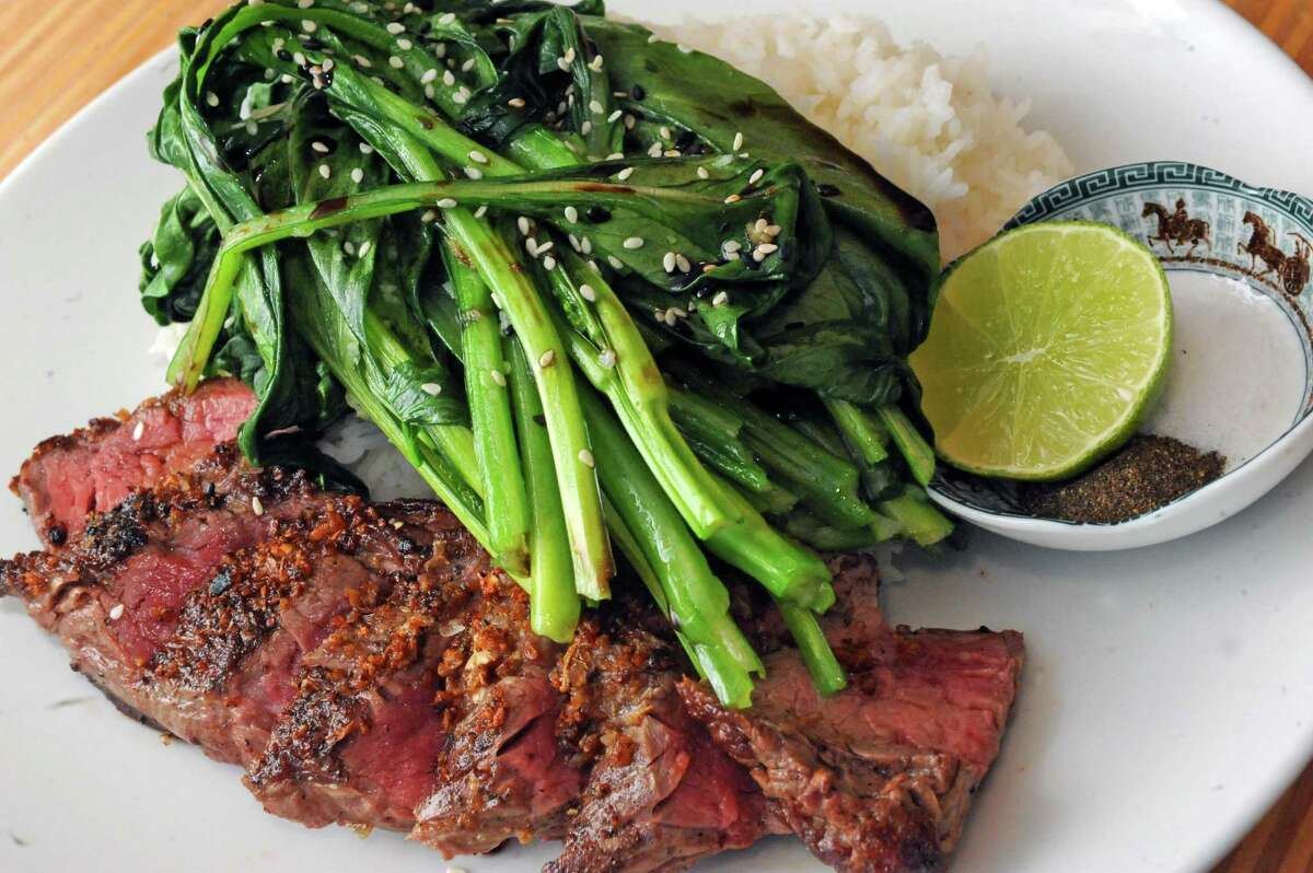 Garlic crusted painted hill sirloin steak with bok choy, jasmine rice and traditional salt-pepper dipping sauce at the Hudson Food Studio on Thursday Feb. 5, 2016 in Hudson, N.Y. (Michael P. Farrell/Times Union)