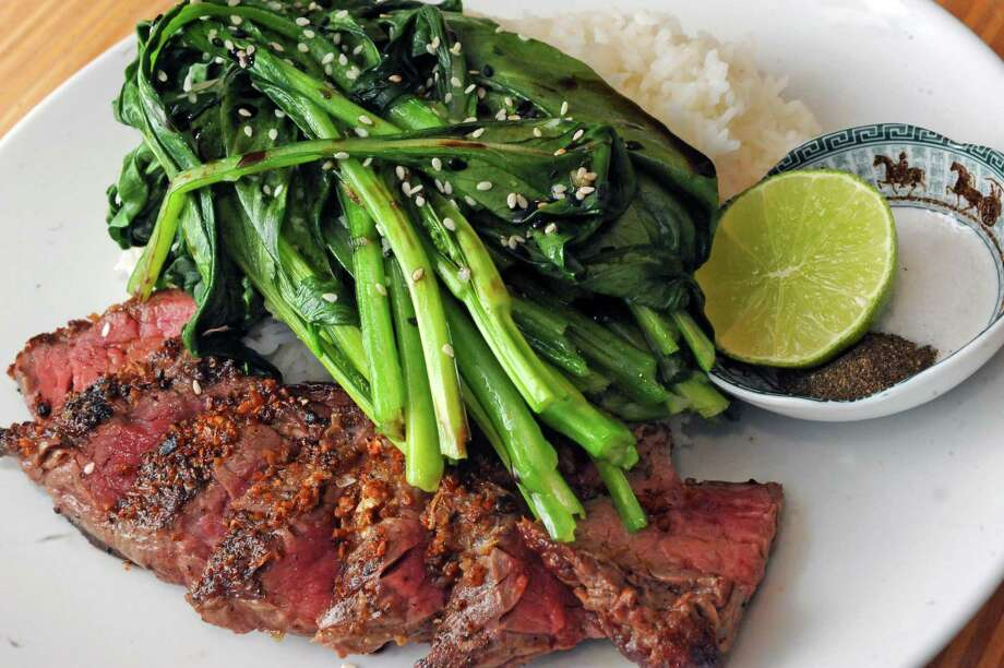 Garlic crusted painted hill sirloin steak with bok choy, jasmine rice and traditional salt-pepper dipping sauce at the Hudson Food Studio on Thursday Feb. 5, 2016 in Hudson, N.Y.  (Michael P. Farrell/Times Union) Photo: Michael P. Farrell / 10035273A