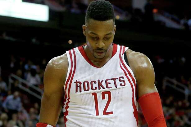 Houston Rockets center Dwight Howard (12) leaves the court after being called for a second technical foul during a game against the Washington Wizards in the fourth quarter at the Toyota Center Saturday, Jan. 30, 2016, in Houston, Texas. Howard was ejected from the game along with Washington Wizards center Nene Hilario (42). Rockets lost 122-123. ( Gary Coronado / Houston Chronicle )