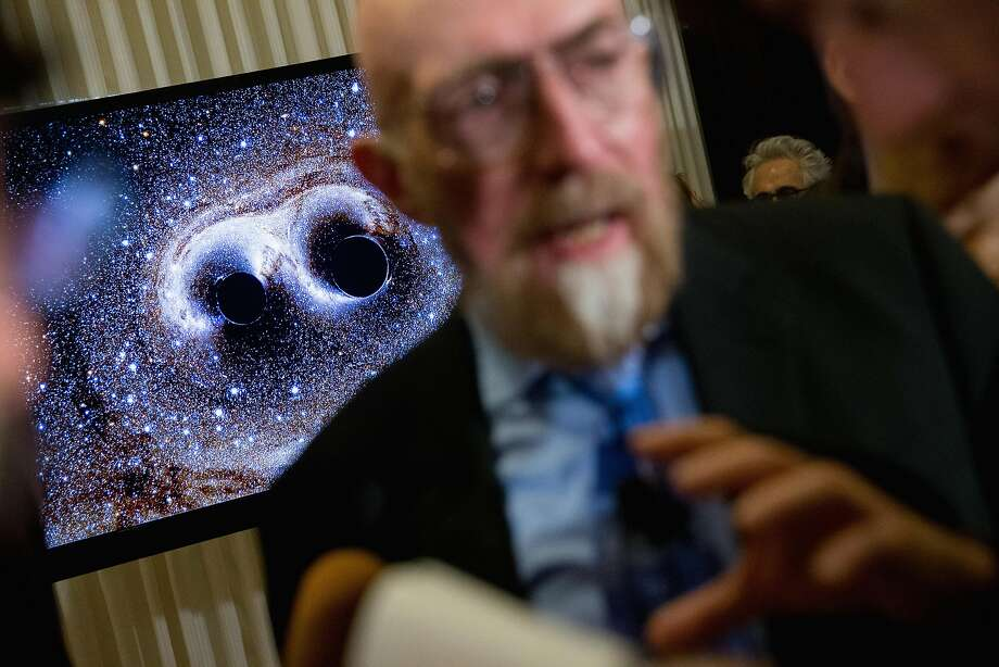Gravitational waves from two converging black holes are depicted on a monitor in Washington. Photo: Andrew Harnik, Associated Press