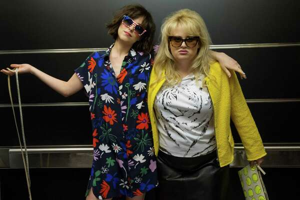 "This image released by  Warner Bros. Entertainment Inc. shows Dakota Johnson, left, and Rebel Wilson in a scene from, ""How to Be Single."" (Barry Wetcher/Warner Bros. Entertainment via AP) Inc.  ORG XMIT: NYET110"