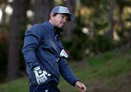 PEBBLE BEACH, CA - FEBRUARY 11:  Mark Wahlberg watches his tee shot on the second hole during the first round of the AT&T Pebble Beach National Pro-Am at the Spyglass Hill Golf Course on on February 11, 2016 in Pebble Beach, California.  (Photo by Sean M. Haffey/Getty Images)
