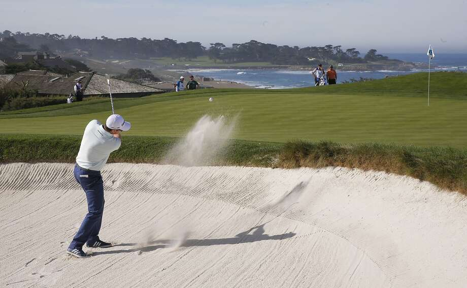Justin Rose hits out of the bunker on the 5th hole at Spyglass Hill during the first round of the AT&T Pebble Beach Pro-Am. Rose is one of the six players ranked in the top nine in the world playing in this year's event. Photo: Michael Macor, The Chronicle