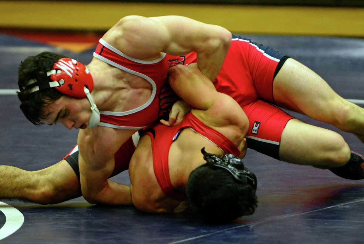 Foran's Jubillie Witte works to turn over Fairield Prep's Orlando Sanchez during wrestling action in Milford, Conn. on Tuesday Dec. 22, 2015.
