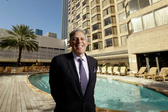 Tom Segesta, general manager of the Four Seasons, 1300 Lamar Street, poses at the pool Wednesday, Feb. 10, 2016, in Houston. The pool area will be undergoing renovations. ( Melissa Phillip / Houston Chronicle )