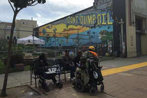 Mural in S.F.'s Bayview aims to curb illegal motor-oil dumping - Photo