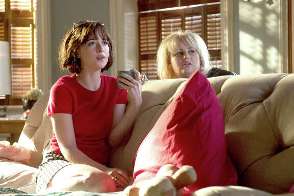 "Alice (Dakota Johnson, left) works at going solo and befriends Robin (Rebel Wilson) in ""How to Be Single."""