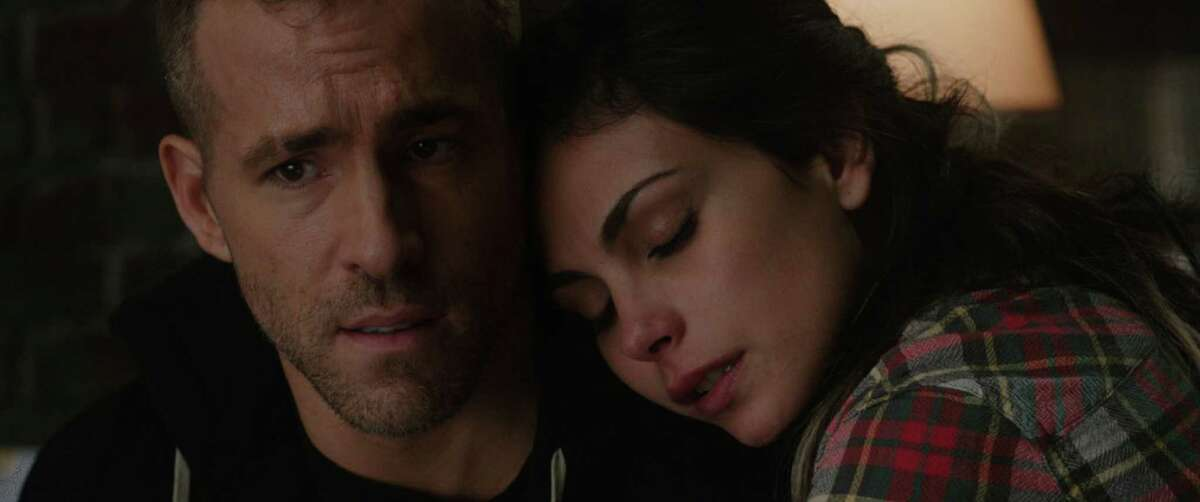 """Ryan Reynolds and Morena Baccarin in """"Deadpool."""" (Photo courtesy 20th Century Fox/TNS)"""