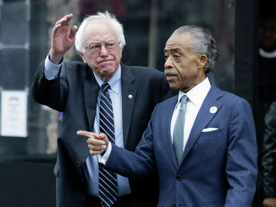 Democratic presidential candidate Sen. Bernie Sanders, I-Vt., left, waves to media and supporters after a breakfast meeting with Rev. Al Sharpton at Sylvia's Restaurant, Wednesday, Feb. 10, 2016, in the Harlem neighborhood of New York. Sanders defeated former Secretary of State Hillary Clinton on Tuesday in the New Hampshire primary. (AP Photo/Seth Wenig) Photo: Seth Wenig, STF / Associated Press / AP