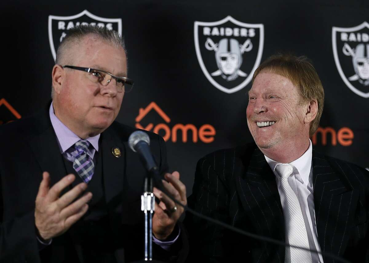 Oakland Coliseum Joint Powers Authority member and Alameda County Supervisor Scott Haggerty, left, gestures beside Oakland Raiders Owner Mark Davis during a media conference Thursday, Feb. 11, 2016, in Oakland, Calif. With the Oakland Raiders' long-term plans still up in the air, team officials announced that the team had agreed to a one-year lease extension to remain at the O.Co Coliseum for the 2016 NFL season. (AP Photo/Ben Margot)