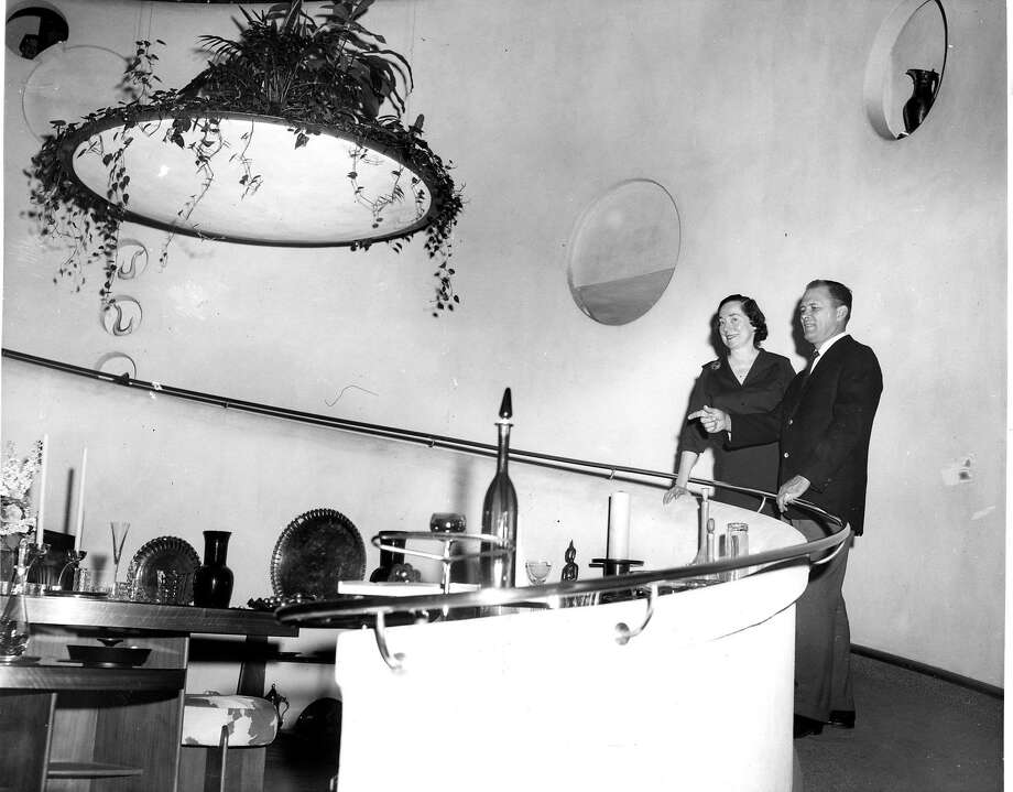 "The V.C. Morris gallery as it appeared in 1960 when Allan Adler — described by The Chronicle as a ""famed silversmith"" — purchased the shop from the estate of the owners who hired truly famed architect Frank Lloyd Wright to transform the space in the late 1940s. Adler is on the right. (Berge Studio) Photo: Xxx"