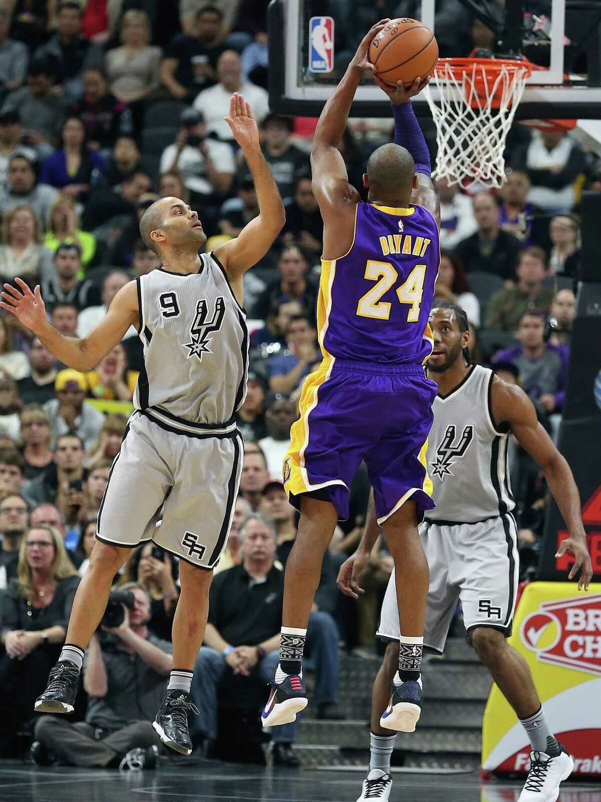 Kobe Bryant gets up to shoot over Tony Parker as the Spurs host the Lakers at the AT&T Center on February 6, 2016.