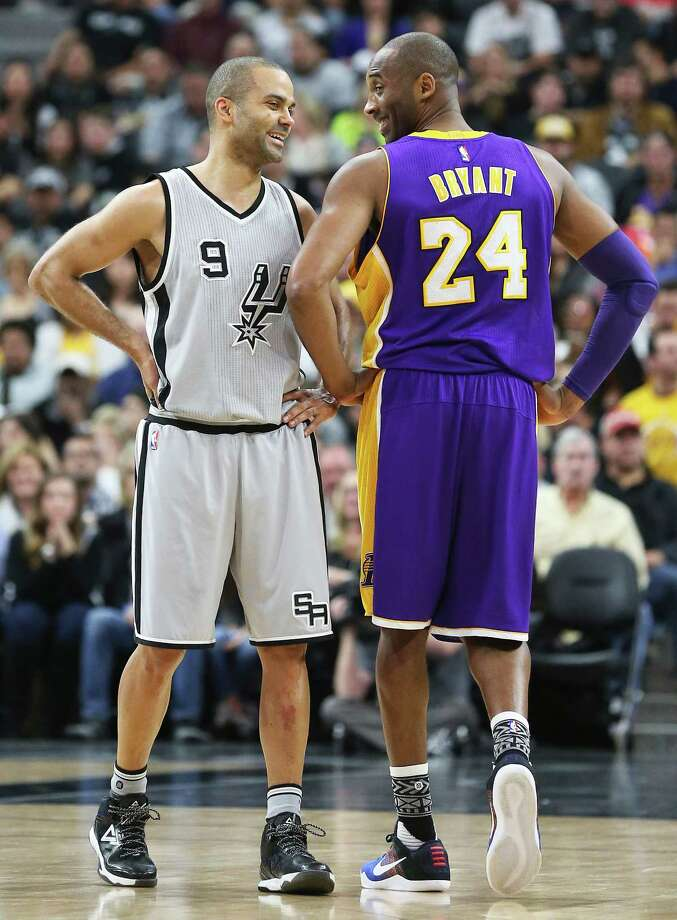 Tony Parker enjoys a light hearted moment with Kobe Bryant during the second quarter as the Spurs host the Lakers at the AT&T Center on February 6, 2016. Photo: TOM REEL, STAFF / SAN ANTONIO EXPRESS-NEWS / 2016 SAN ANTONIO EXPRESS-NEWS