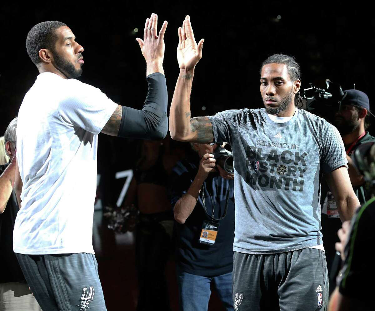 LaMarcus Aldridge and Kawhi Leonard high five during introductions as the Spurs host the Lakers at the AT&T Center on February 6, 2016.