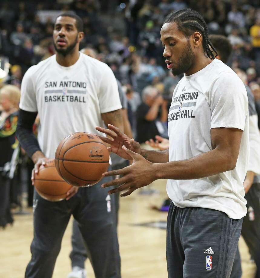 Kawhi Leonard and LaMarcus Aldridge warm up as the Spurs host the Lakers at the AT&T Center on February 6, 2016. Photo: TOM REEL, STAFF / SAN ANTONIO EXPRESS-NEWS / 2016 SAN ANTONIO EXPRESS-NEWS