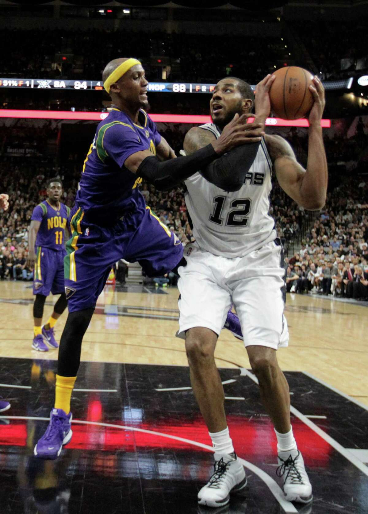 San Antonio Spurs' LaMarcus Aldridge is fouled by New Orleans Pelicans' Dante Cunningham during the second half at the AT&T Center, Wednesday, Feb. 3, 2016.