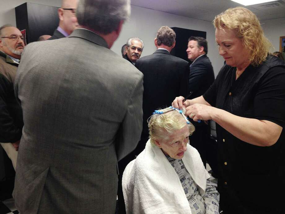 Albany County Nursing Home resident, Margaret Schlisser gets her hair done by beautician Janet Palmer as elected county officials take part in a press conference to show off the renovated beauty salon and remodeled showers and bathrooms at the County nursing home on Thursday, Feb. 11, 2016, in Colonie, N.Y.  Nursing home staff did most of the renovation in the salon and an outside company did the remodeling of the showers and baths.  (Paul Buckowski / Times Union) Photo: PAUL BUCKOWSKI / 10035380A