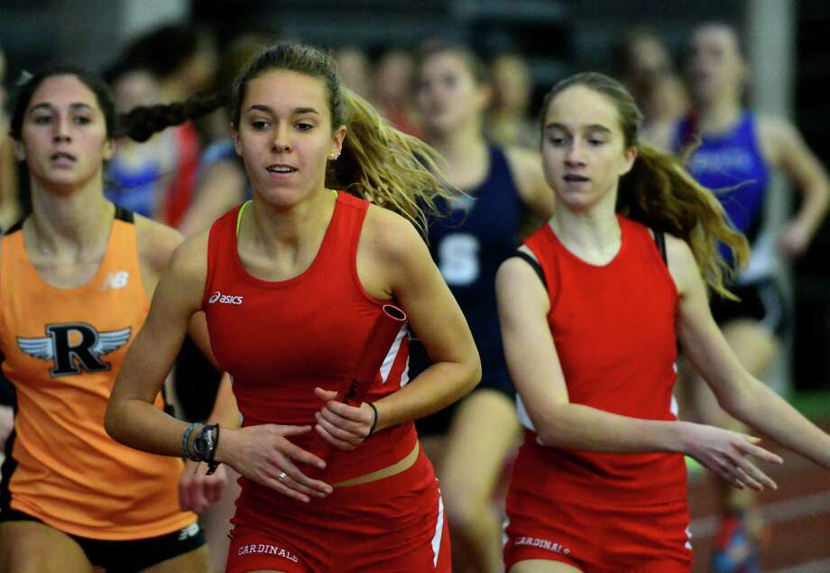 Greenwich's Sabrina Thurber receives the baton from teammate Lauren O'Donnell, right, in the 4X800 relay race during CIAC Class LL Indoor Track and Field Championships in New Haven, Conn. on Thursday Feb. 11, 2016. Photo: Christian Abraham / Hearst Connecticut Media / Connecticut Post