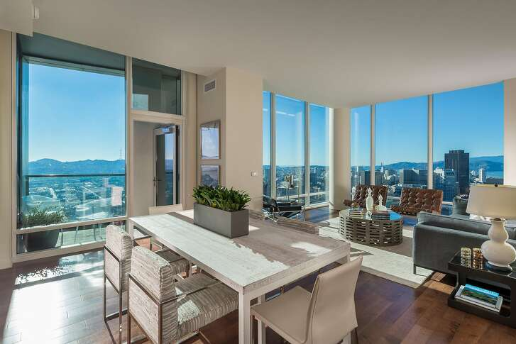Eleven-foot windows in the showcase living/dining room frame unparalled views.