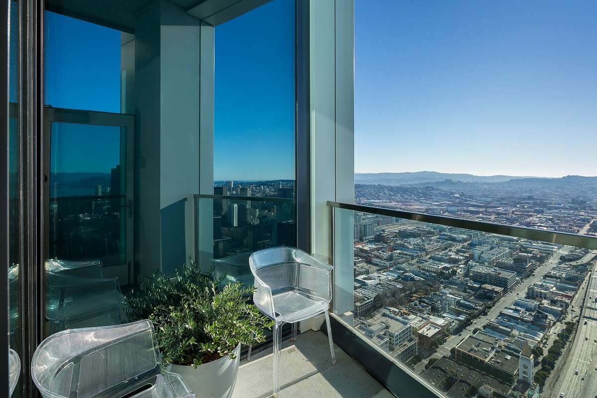 The 60th-floor penthouse includes a west-facing view deck overlooking various city landmarks and neighborhoods.
