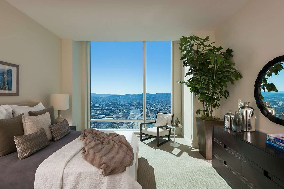 The carpeted master suite enjoys exceptional views and abundant natural light.