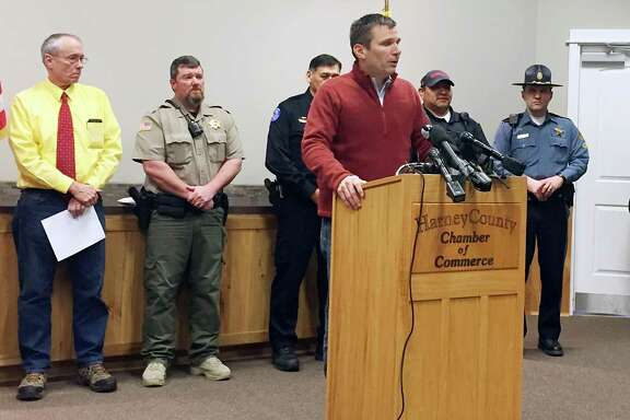 FBI Special Agent in Charge Greg Bretzing, at podium, talks to reporters at the Chamber of Commerce in Burns, Ore., Thursday, Feb. 11, 2016. The end of a nearly six-week-long standoff at an Oregon wildlife refuge played out live on the Internet, with tens of thousands of people listening as supporters encouraged the last armed occupiers to surrender. The holdouts surrendered Thursday, having refused to leave Malheur National Wildlife Refuge after the group's leaders were arrested last month.(AP Photo/Rebecca Boone)