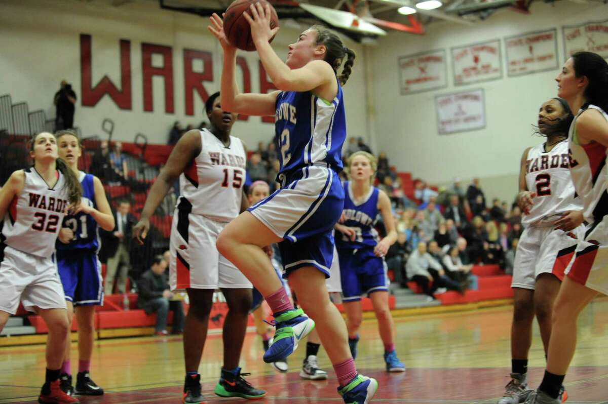 Regan Steed (22) of Fairfield Ludlowe drives for a lay up during a game against Fairfield Warde at Fairfield Warde High School on February 11, 2016 in Fairfield, Connecticut.